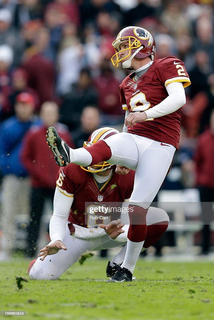 Holder Sav Rocca #6 and kicker Kai Forbath #2 of the Washington Redskins follow Forbath's field goal against the Philadelphia Eagles at FedEx Field on November 18, 2012 in Washington, DC.