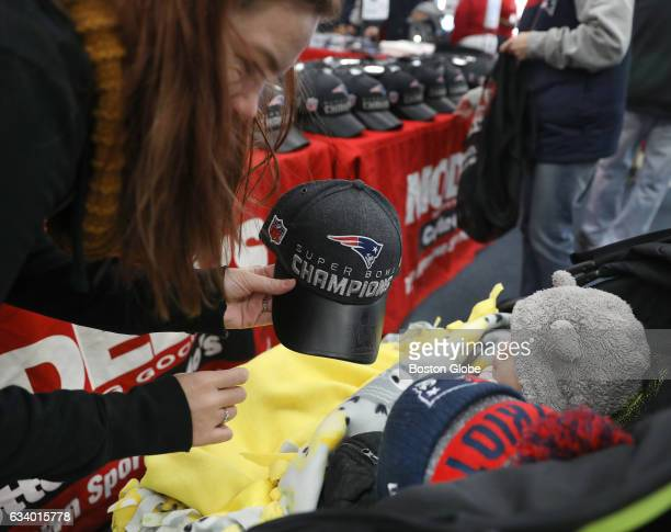 Holding a $40 locker room hat Kelly Santos of Woburn asks her 10monthold son Logan Santos 'Get that for Daddy' A friend right shares the stroller New...