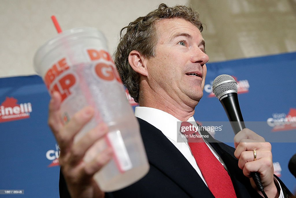 Holding a 'Big Gulp' while referencing New York City Mayor Michael Bloomberg, U.S. Sen. <a gi-track='captionPersonalityLinkClicked' href=/galleries/search?phrase=Rand+Paul&family=editorial&specificpeople=6939188 ng-click='$event.stopPropagation()'>Rand Paul</a> speaks at a 'Get out the Vote' rally for Virginia Attorney General Ken Cuccinelli, the Republican candidate for Governor of Virginia, October 28, 2013 in Fairfax, Virginia. Cuccinelli is running against Democratic candidate Terry McAullife in a very close race.