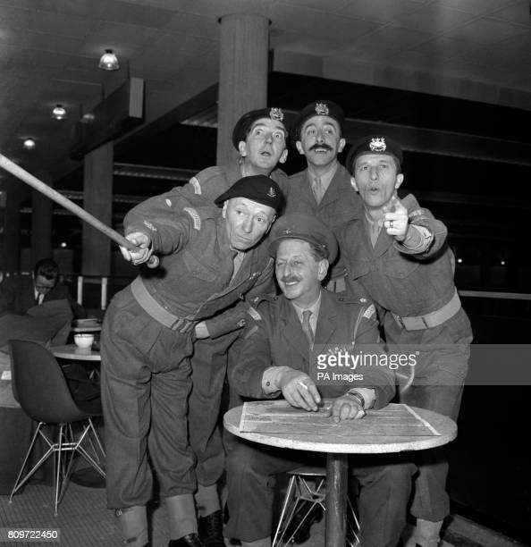 Holding a briefing conference in a lounge at Gatwick Airport are Major UpshotBagley and other ranks of Granada Television's 'The Army Game' They are...