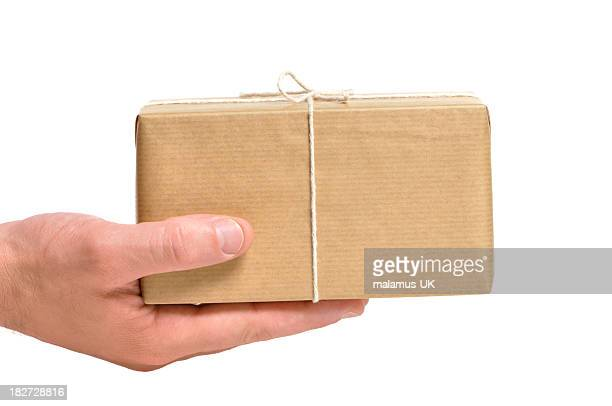 Holding a brown wrapped parcel