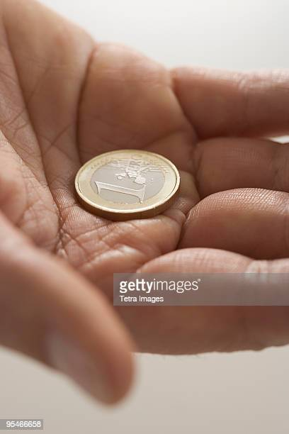 Holding a coin