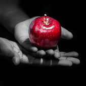 Here is a picture of a person holding a red apple