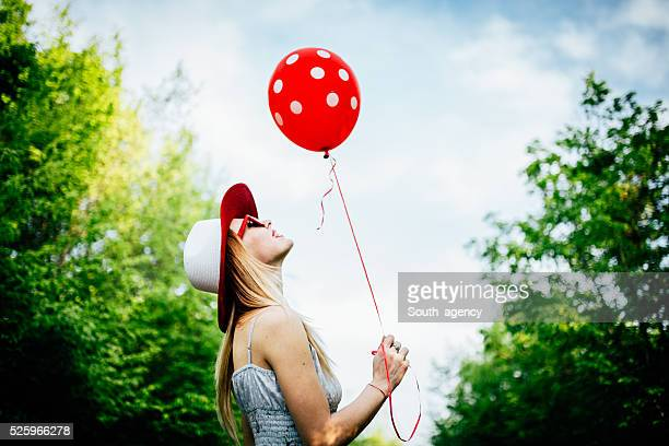 Holding a red balloon