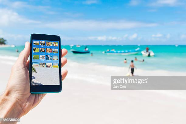 Holding a smartphone in caribbean Punta Cana of Dominican Republic