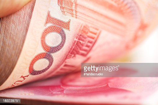 Holding a stack of chinese mone