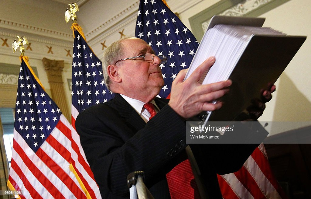 Holding a stack of evidentiary papers, Sen. Carl Levin (D-MI) answers questions relating to the disclosure of Goldman Sachs internal emails April 26, 2010 in Washington, DC. Levin, a member of the the Senate Homeland Security and Governmental Affairs Committee's Investigations Subcommittee held a press conference prior to a hearing tomorrow on 'Wall Street and the Financial Crisis: The Role of Investment Banks.