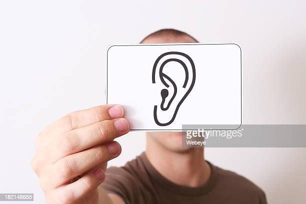 Holding an ear