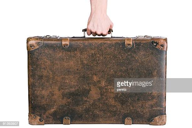 holding an old suitcase