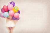 Holding balloons