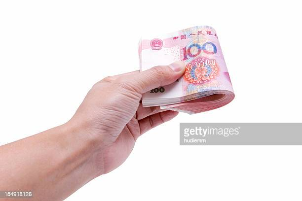 Holding banknotes (clipping path) isolated on white background