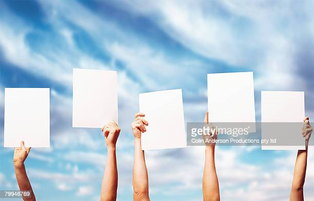 Holding Blank Score Cards