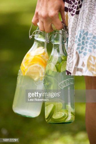 Holding bottle of lemonade