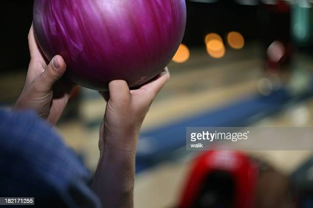 Holding bowling ball