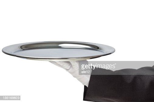 Holding empty silver tray in gloved hand