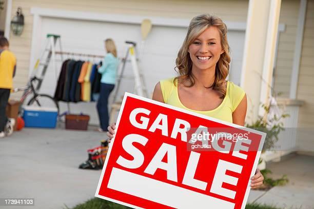 Holding Garage Sale Sign