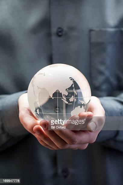 Holding globe - Asia