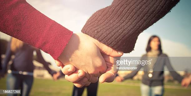 Holding hands, multiracial couple in love