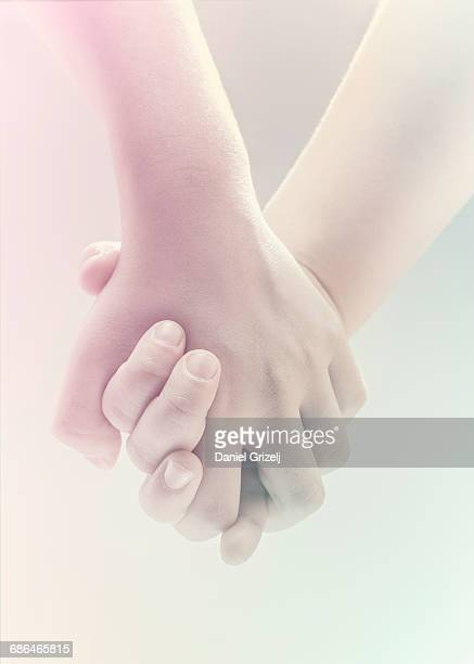 holding hands touching each other