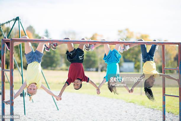 Holding Hands Upside Down on Monkey Bars