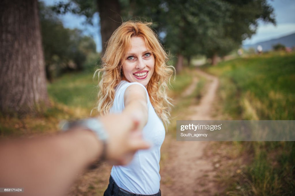 Holding her lover's hand : Stock Photo