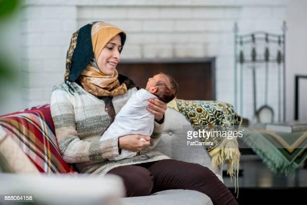 Holding Her Newborn Baby