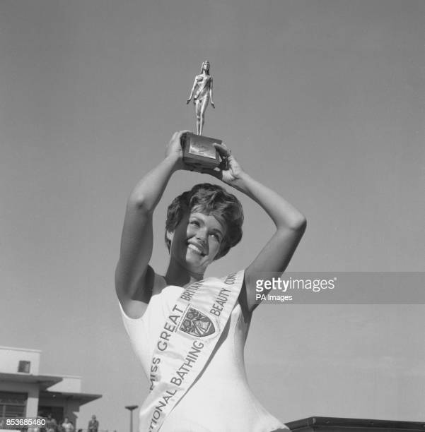 Holding her trophy high in the air is 24yearold Joy Black of Loch Foot Dumfries Scotland who yesterday was crowned Miss Great Britain held at...