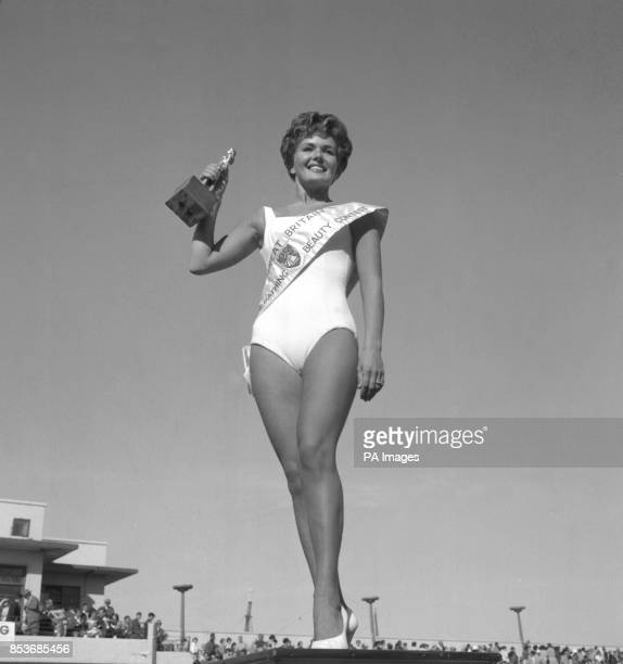 Holding her trophy high is 24yearold Joy Black of Loch Foot Dumfries Scotland who yesterday was crowned Miss Great Britain held at Morecambe...