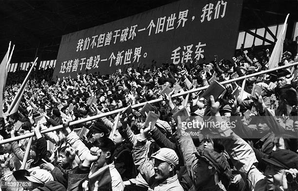 Holding high the red covered 'Quotations from Chairman Mao Tsetung' young revolutionary fighters of the Red Guards Congress of Peking middle schools...