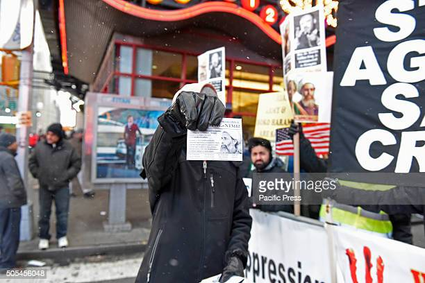 Holding out leaflet to passersby Hundreds of Muslims gathered in Times Square to protest against the Saudi government's execution of dissident sheikh...