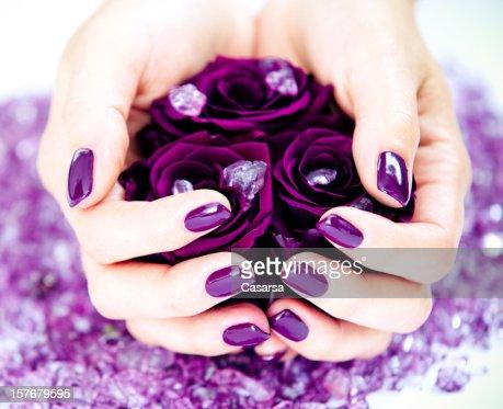 Holding purple roses