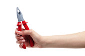 Beautiful female hand holding red pliers on white background XXXL