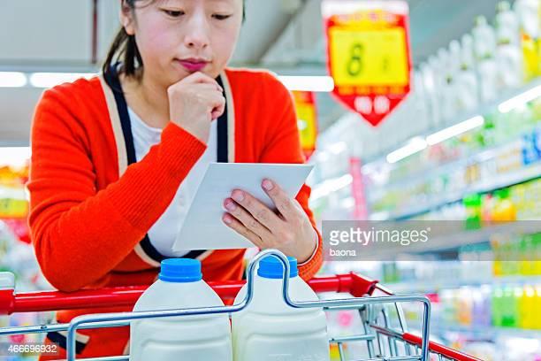 holding shopping list