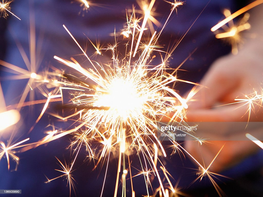 Holding sparkler : Stock Photo