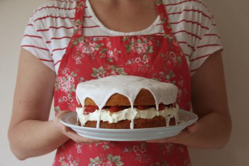 Holding strawberry sponge cake.