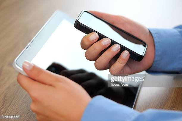 Holding tablet pc and smart phone