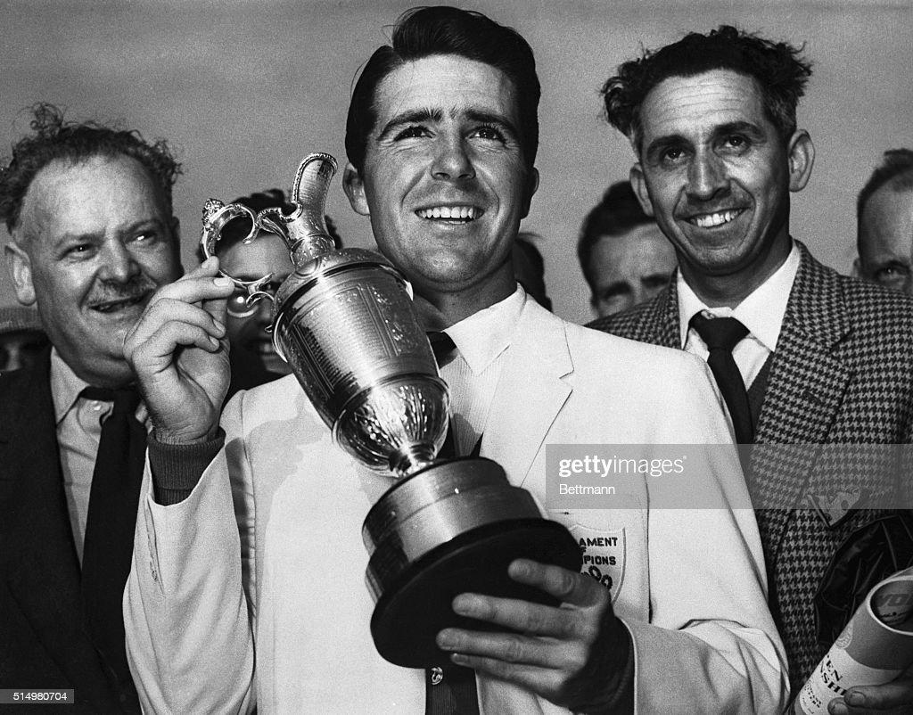 Holding up his trophy, <a gi-track='captionPersonalityLinkClicked' href=/galleries/search?phrase=Gary+Player&family=editorial&specificpeople=203189 ng-click='$event.stopPropagation()'>Gary Player</a> (center), winner of the British Open Golf Championship, smiles here, July 3rd. Player, 23, comes from South Africa. His winning score was 68. Others in the photo are unidentified.