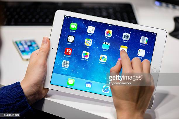 Holding white iPad Air