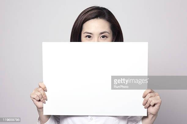 holding whiteboard ,young business woman