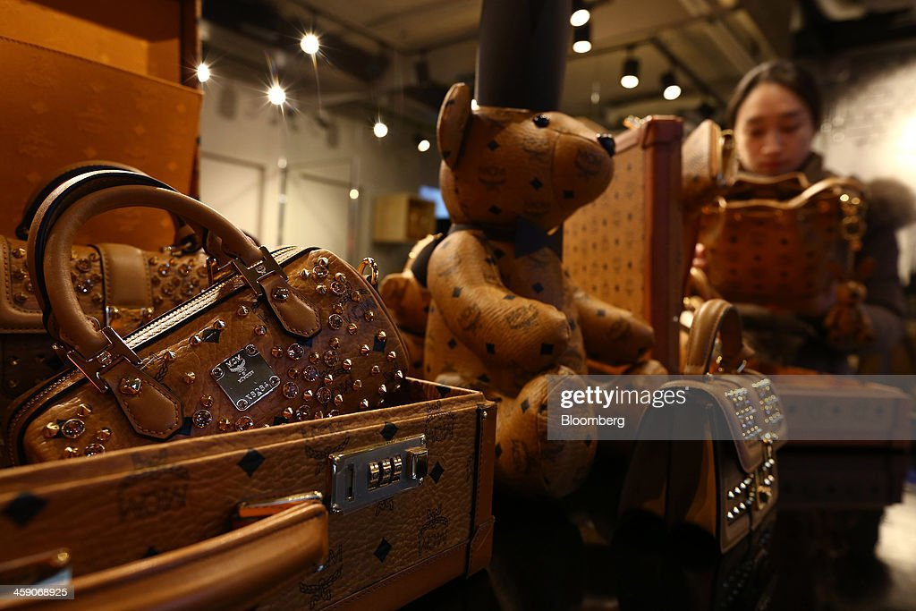 MCM Holdings AG bags are displayed for sale inside the company's store on Garosugil street in the Gangnam district of Seoul, South Korea, on Sunday, Dec. 22, 2013. Consumer prices climbed 0.9 percent in November from a year earlier after a 0.7 percent increase in October that was the smallest gain since July 1999. Photographer: SeongJoon Cho/Bloomberg via Getty Images