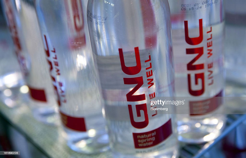 GNC Holdings Inc. water bottles are displayed for sale at a store in New York, U.S., on Thursday, Feb. 14, 2013. GNC Holdings Inc., a retailer of health and wellness products, reported revenue increases of 10.9% in the fourth quarter and 17.3% for the full year. Photographer: Jin Lee/Bloomberg via Getty Images