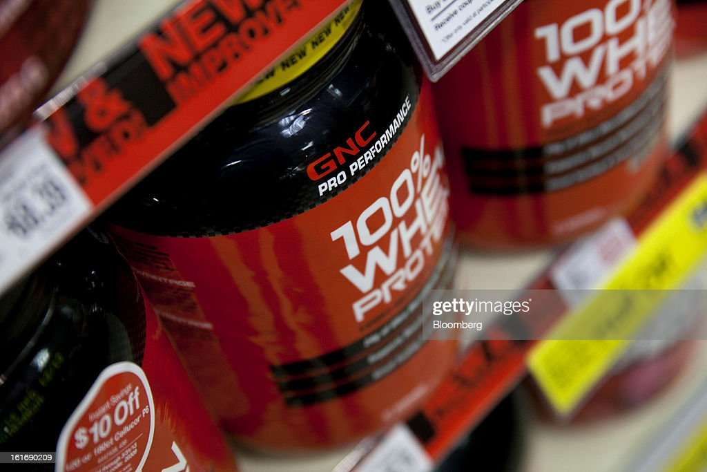 GNC Holdings Inc. weight gaining powder are displayed for sale at a store in New York, U.S., on Thursday, Feb. 14, 2013. GNC Holdings Inc., a retailer of health and wellness products, reported revenue increases of 10.9% in the fourth quarter and 17.3% for the full year. Photographer: Jin Lee/Bloomberg via Getty Images