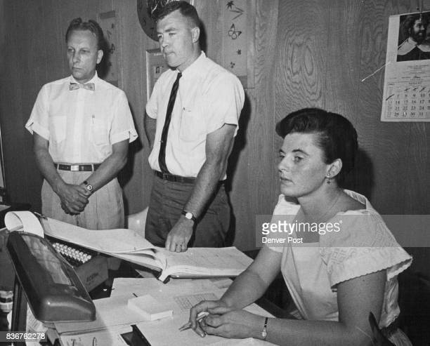 Holdup Men Made These Three Employes Lean Against The Wall From left Peter DeHaas Don Ewen and Mrs Anne Tomlin discuss $3000 robbery Credit Denver...