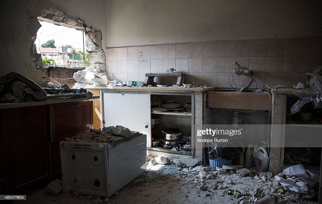 A hole, allegedly caused by a Hamas rocket, is seen in an Israeli home on July 21, 2014 in Sderot, Israel. Yesterday marked the bloodiest day of the operation 'Protective Edge' yet, as 13 Israeli soldiers died and the death toll in Gaza passed 500 people.