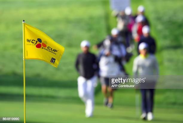 A hole flag is seen as Jason Day of Australia and Rafa Cabrera Bello of Spain walk the fairway on the 2nd hole during the final round of the CJ Cup...