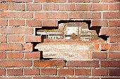 A hole in a brick wall