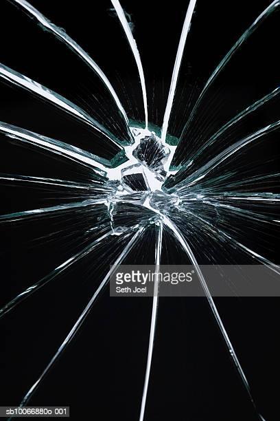 Hole in broken shattered mirror, studio shot