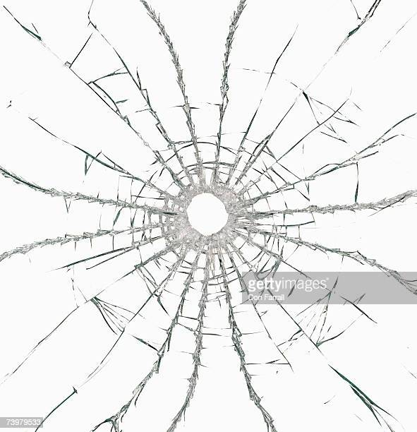 Hole in glass against white background