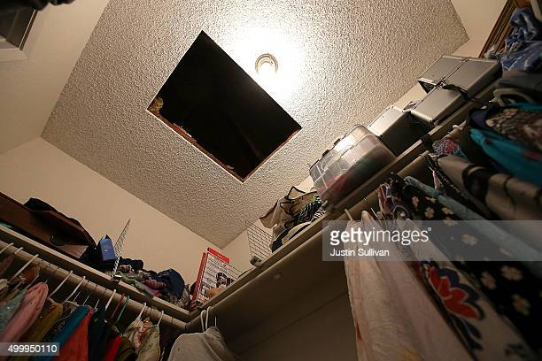 A hole in the ceiling is visible in a bedroom closet inside the home of shooting suspect Syed Farook on December 4 2015 in Redlands California The...