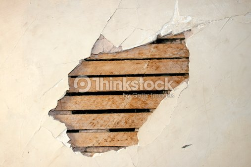 Hole In The Wall Cracked Plaster Stock Photo Thinkstock